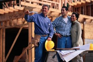 Contractor Talking to Couple on Construction Site